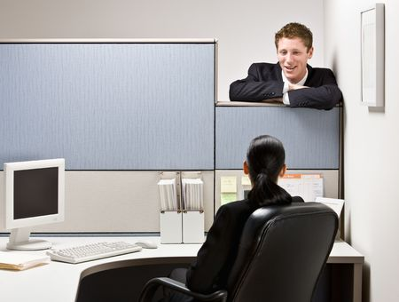 Businessman talking to co-worker photo