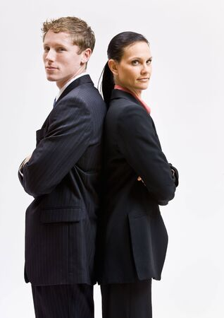 Business people standing back to back photo