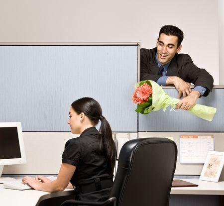 bringing: Businessman bringing co-worker flowers