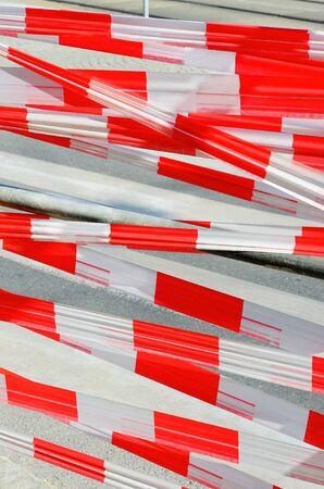 caution tape - white and red on construction side