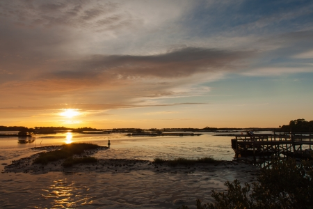eventide: Cedar Key, Florida is on the West coast at the beginning of the turn into the Florida panhandle. It is known for gorgeous sunsets and it doesnt disappoint.