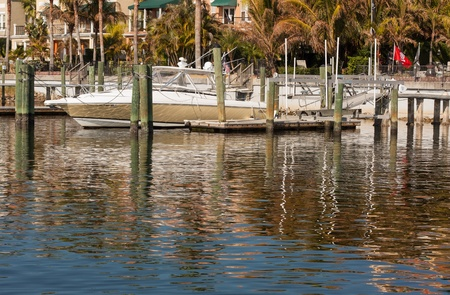 get across: The residents of these river homes in Tampa, Florida, not only have beautiful views of the area they also get entertained by the ever changing dancing reflections across the water  Stock Photo