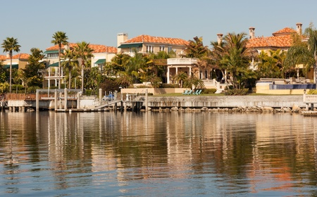 The residents of these river homes in Tampa, Florida, not only have beautiful views of the area they also get entertained by the ever changing dancing reflections across the water. Stock Photo