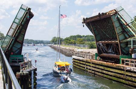 drawbridge: Boats are entering the sanctuary of the harbor after their journies
