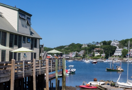 Tourist venues, homes, boats of all kinds are represented in this image of Rockport Harbor, MA