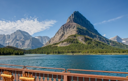 This image is looking directly across the Swiftcurrent Lake at Grinnell Point from the Many Glacier Hotel patio in Glacier National Park  photo