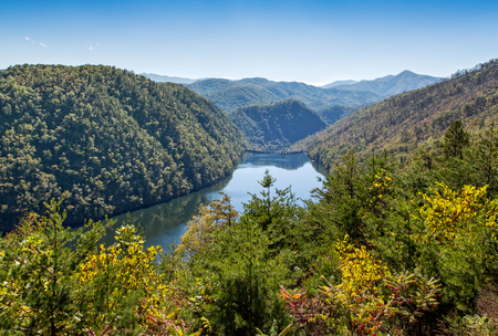 fugitive: This is a view from behind the Cheoah Dam on the Little Tennessee River. The dam was used in the movie The Fugitive which led it to be renamed the Fugitive Dam.
