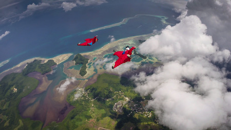 parachute jump: Wingsuit Flying Over Palau Coast