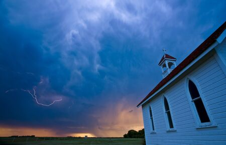 Storm Clouds over Saskatchewan country church photo