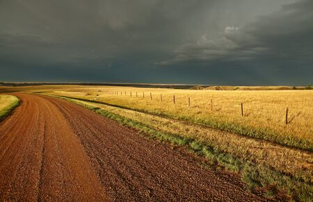 Storm clouds along a Saskatchewan country road photo