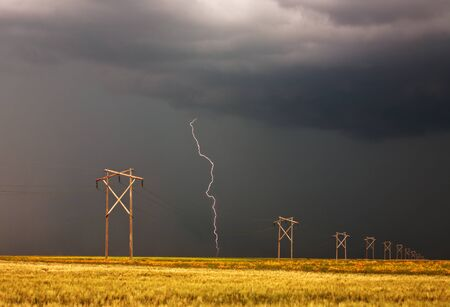 Lightning striking behind Saskatchewan power line Stock Photo - 8388906