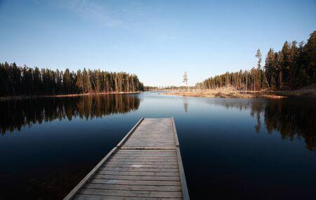 Dock on Northern Manitoba lake photo