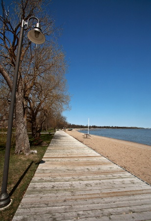 lake winnipeg: boardwalk and sand at Winnipeg Beach Manitoba Stock Photo