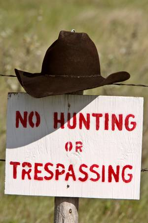 Cowboy hat over posted sign in Saskatchewan Stock Photo - 8418993