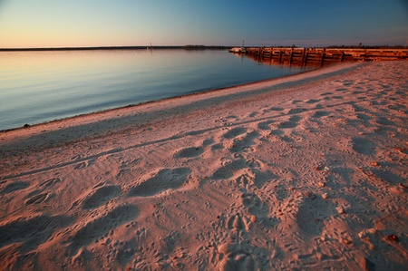 lake winnipeg: Beach and dock along shore of Lake Winnipeg Stock Photo