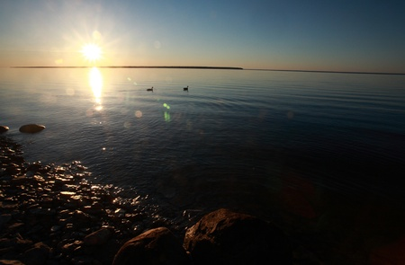 lake winnipeg: Reflected sunrise along shore of Lake Winnipeg