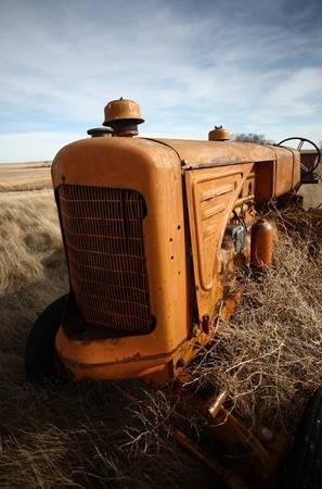 Tumbleweeds piled against abandoned tractor Stock Photo - 8442169
