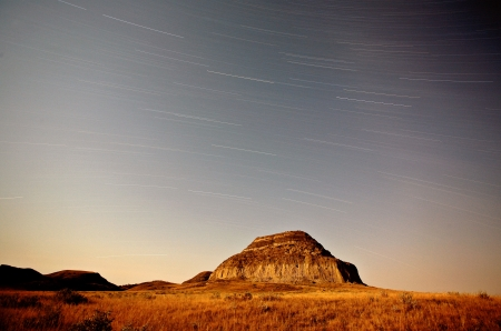 butte: Moon lit Castle Butte and star tracks in scenic Saskatchewan