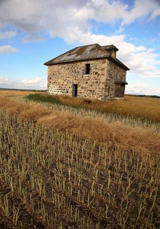 Abandoned stone house in scenic Saskatchewan Stock Photo - 8451188