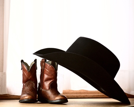 Cowboy hat leaning on boots