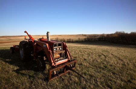 Sunlit tractor in field in Saskatchewan Stock Photo - 8458948