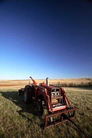 Sunlit tractor in field in Saskatchewan Stock Photo - 8458940
