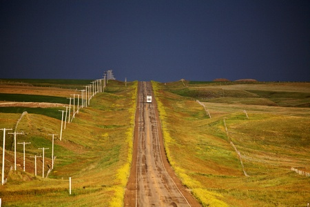 Storm clouds seen along a Saskatchewan country road Stock Photo - 8458956