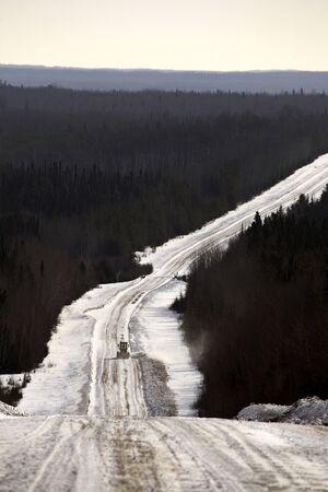 grader: logging road in winter