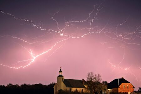Lightning bolts over Spring Valley country church Stock Photo