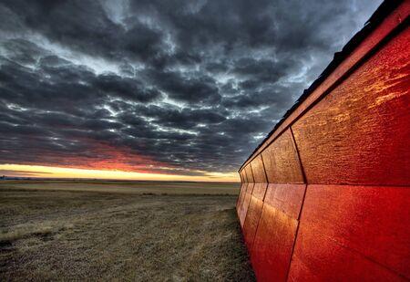 Sunset Saskatchewan Canada red sky farm granary barn Stock Photo - 8482831