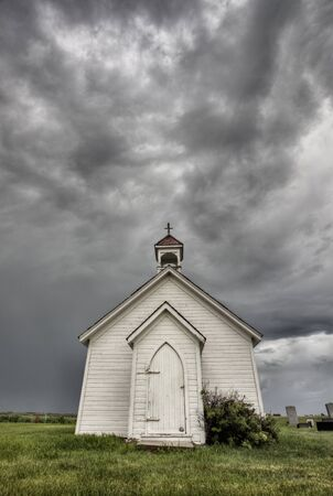 Old Country Church with storm clouds Stock Photo