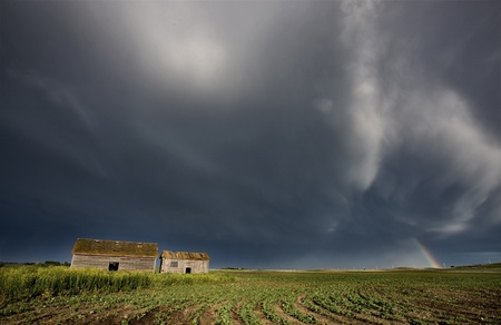 Abandoned Farm house with stormy clouds photo