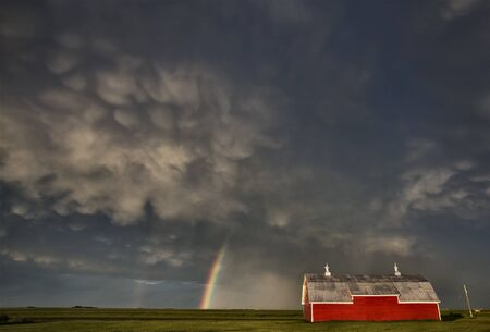 Old Red Barn and Storm and Rainbow photo