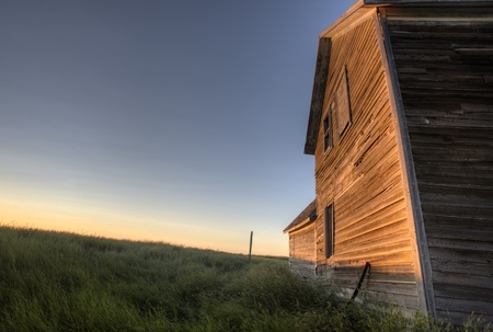 Abandoned Farmhouse Saskatchewan Canada sunset and prairie view Stock Photo - 10702542