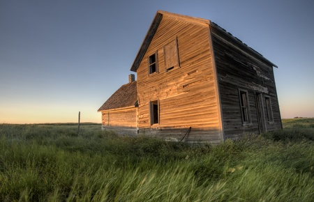 damaged roof: Abandoned Farmhouse Saskatchewan Canada sunset and prairie view