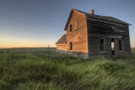 Abandoned Farmhouse Saskatchewan Canada sunset and prairie view Stock Photo - 10695335