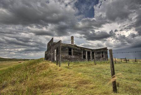 wood abandoned: Abandoned Farmhouse Saskatchewan Canada sunset and prairie view