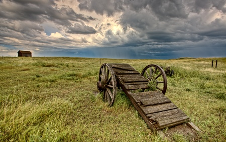 old wood farm wagon: Old Prairie Wheel Cart Saskatchewan Canada field Stock Photo