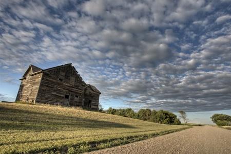 Abandoned Farmhouse Saskatchewan Canada sunset and prairie view Stock Photo - 10702565