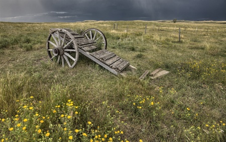 Old Prairie Wheel Cart Saskatchewan Canada field photo