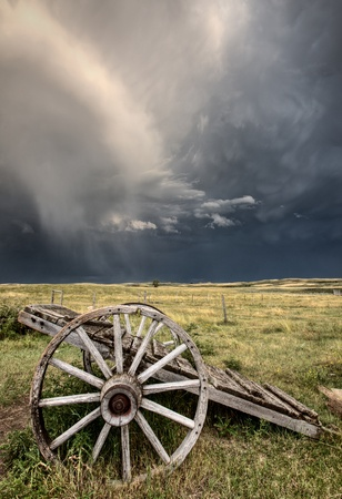 Old Prairie Wheel Cart Saskatchewan Canada field Stock Photo