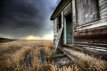 abandoned: Abandoned Farmhouse Saskatchewan Canada sunset and prairie view