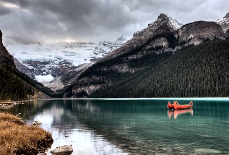 Lake Louise Glacier  canoe and emerald color photo