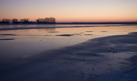 Sunset on Frozen Lake in Saskatchewan Canada Stock Photo - 12506977
