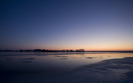 Sunset on Frozen Lake in Saskatchewan Canada Stock Photo - 12506940