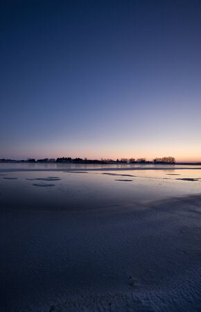 Sunset on Frozen Lake in Saskatchewan Canada Stock Photo - 12506979