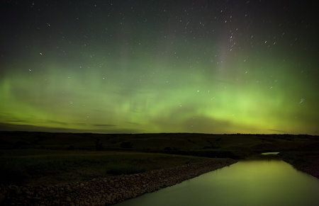 Northern Lights over Saskatchewan River night shot photo