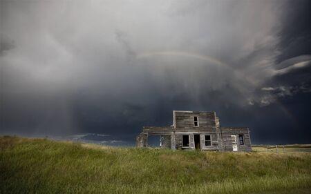 Storm over abandoned farm house in Saskatchewan Canada Stock Photo - 12919158