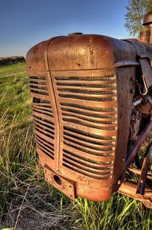 Antique Farm Equipment sunset Saskatchewan Canada Stock Photo - 13850083