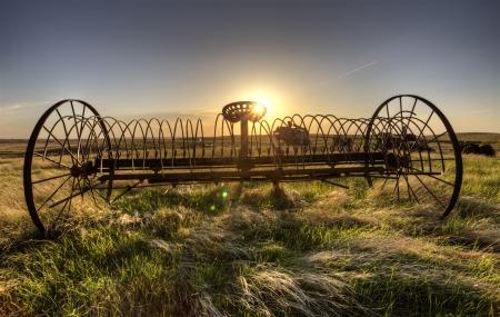 farm equipment: Antique Farm Equipment sunset Saskatchewan Canada